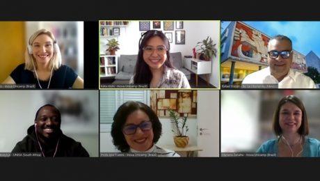 Print de tela em que aparecem seis pessoas, entre eles os palestrantes do evento e a moderadora. Ao todo, são três mulheres brancas, uma mulher amarela, um homem branco e um homem preto na imagem.